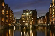 "The""Water Castle"" (C) is pictured in the famous old warehouse district of Speicherstadt in Hamburg, late October 30, 2012. REUTERS/Fabian Bimmer"