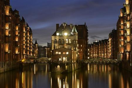 The''Water Castle'' (C) is pictured in the famous old warehouse district of Speicherstadt in Hamburg, late October 30, 2012. REUTERS/Fabian Bimmer