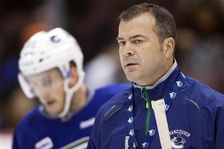 Vancouver Canucks head coach Alain Vigneault looks on during the second day of training camp in Vancouver, British Columbia January 14, 2013. REUTERS/Ben Nelms