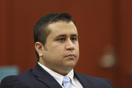 George Zimmerman listens as his defense counsel Mark O'Mara questions potential jurors during jury selection in his trial in Seminole circuit court in Sanford, Florida Thursday, June 20, 2013. REUTERS/Gary W. Green/Pool