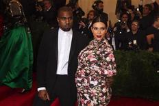 "Singer Kanye West and reality television actress Kim Kardashian arrive at the Metropolitan Museum of Art Costume Institute Benefit celebrating the opening of ""PUNK: Chaos to Couture"" in New York, May 6, 2013. REUTERS/Lucas Jackson"