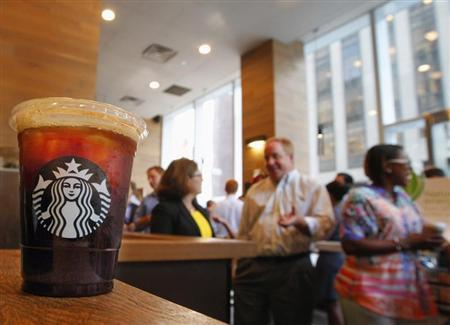 An iced coffee sits on a counter in a Starbucks outlet in New York July 25, 2012. REUTERS/Brendan McDermid