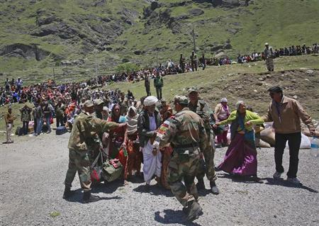 Soldiers stop survivors from going near an army helicopter as its lands during rescue operations at Badrinath in the Himalayan state of Uttarakhand June 21, 2013. REUTERS/Danish Siddiqui