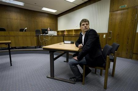Former Tour de France winner Jan Ullrich of Germany sits in a courtroom in the western German city of Duesseldorf November 12, 2008. REUTERS/Wolfgang Rattay