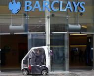 A woman sits in her mobility scooter outside a Barclays Bank in Leicester, central England April 24, 2013. REUTERS/Darren Staples