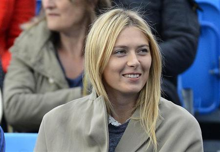 Russia's Maria Sharapova watches Bulgaria's Grigor Dimitrov play Israel's Dudi Sela in their men's singles tennis match at the Queen's Club Championships in west London June 10, 2013. REUTERS/Toby Melville