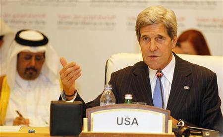 U.S. Secretary of State John Kerry (R) speaks during the London 11 countries ''Friends of Syria'' meeting in Doha June 22, 2013. REUTERS/Mohammed Dabbous