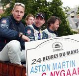 Dinamarquês Allan Simonsen (E) durante desfile com colegas de equipe antes da corrida automobilística 24 Horas de Le Mans, na França. O piloto Simonsen morreu após um acidente na corrida 24 Horas de Le Mans neste sábado, na França, informaram os organizadores. 21/06/2013 REUTERS/Stringer