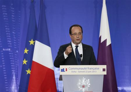 French President Francois Hollande speaks at the opening of the Lycee Franco-Qatarien Voltaire school in Doha June 22, 2013. REUTERS/Fadi Al-Assaad