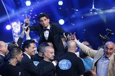 "Palestinian singer Mohammed Assaf reacts after being announced winner of the Season 2 finale of ""Arab Idol"" in Zouk Mosbeh area, north of Beirut June 22, 2013. REUTERS/Mohammed Azakir"
