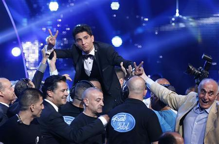 Palestinian singer Mohammed Assaf reacts after being announced winner of the Season 2 finale of ''Arab Idol'' in Zouk Mosbeh area, north of Beirut June 22, 2013. REUTERS/Mohammed Azakir
