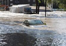 An abandoned car sit submerged on a flooded street in the Mission area of Calgary, Alberta June 22, 2013. REUTERS/Melissa Renwick