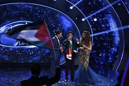 Palestinian singer Mohammed Assaf speaks on stage after being announced the winner during the Season 2 finale of ''Arab Idol'' in Zouk Mosbeh area, north of Beirut June 22, 2013. REUTERS/Mohammed Azakir