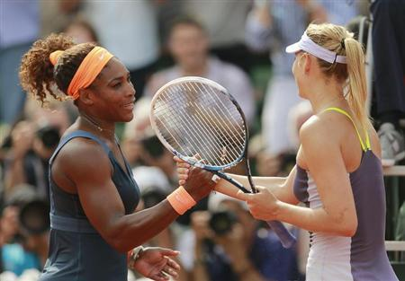Serena Williams of the U.S. shakes hands with Maria Sharapova (R) of Russia after winning their women's singles final match at the French Open tennis tournament at the Roland Garros stadium in Paris June 8, 2013. REUTERS/Vincent Kessler