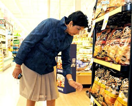 PepsiCo CEO Indra Nooyi checks products at the Tops SuperMarket in Batavia, New York, June 3, 2013. REUTERS/Don Heupel