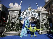 "Life-sized characters of Mike (R) and Sullivan pose at the premiere of the film ""Monsters University"" at El Capitan theatre in Hollywood, California June 17, 2013. REUTERS/Mario Anzuoni"
