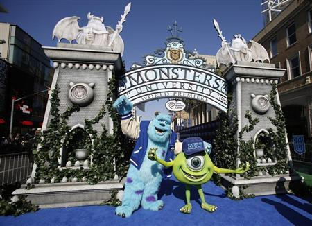 Life-sized characters of Mike (R) and Sullivan pose at the premiere of the film ''Monsters University'' at El Capitan theatre in Hollywood, California June 17, 2013. REUTERS/Mario Anzuoni