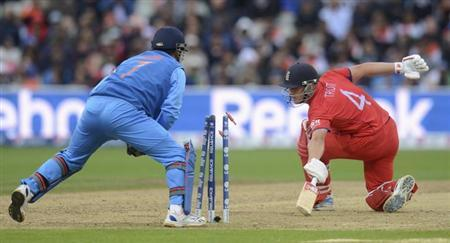 He Is Stumped By Indias Mahendra Singh Dhoni During The ICC Champions Trophy Final Cricket Match At Edgbaston Ground Birmingham June 23 2013