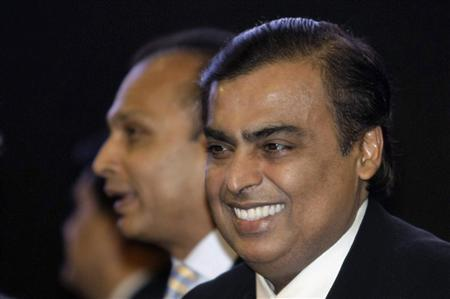 Mukesh Ambani (R), chairman of Reliance Industries, smiles as his brother Anil Ambani, chairman of Reliance Group, stands behind him during the inauguration ceremony of the Vibrant Gujarat global investor summit at Gandhinagar in the western Indian state of Gujarat in this January 11, 2013 file photo. REUTERS/Amit Dave/Files