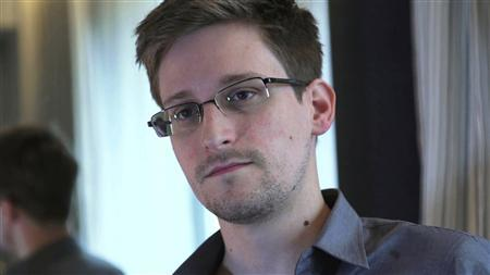 NSA whistleblower Edward Snowden, an analyst with a U.S. defence contractor, is seen in this still image taken from video during an interview by The Guardian in his hotel room in Hong Kong June 6, 2013. REUTERS/Glenn Greenwald/Laura Poitras/Courtesy of The Guardian/Handout via Reuters/Files