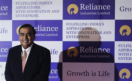 Mukesh Ambani, chairman of Reliance Industries Limited, poses for photographers before addressing the annual shareholders meeting in Mumbai June 6, 2013. REUTERS/Danish Siddiqui/Files