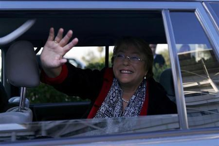Former Chilean president and former executive director of gender equality body U.N. Women Michelle Bachelet waves to her supporters at Santiago airport March 27, 2013. REUTERS/Ivan Alvarado