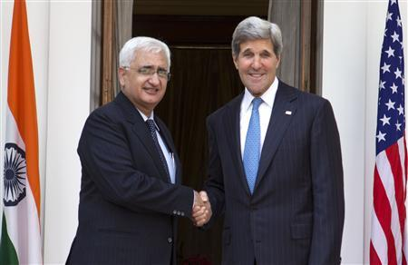 U.S. Secretary of State John Kerry (R), on his first visit to India as secretary, poses with Indian Foreign Minister Salman Khurshid for photographers at Hyderabad House in New Delhi, June 24, 2013. REUTERS/Jacquelyn Martin/Pool