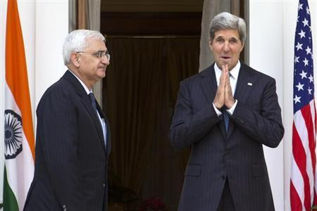 U.S. Secretary of State John Kerry (R), on his first visit to India as secretary, gestures to the media at the end of a photo opportunity with Indian External Affairs Minister Salman Khurshid at Hyderabad House in New Delhi, June 24, 2013. REUTERS/Jacquelyn Martin/Pool