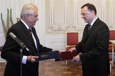 Czech Prime Minister Petr Necas (R) tenders his resignation to President Milos Zeman at the Prague Castle June 17, 2013. REUTERS/David W Cerny
