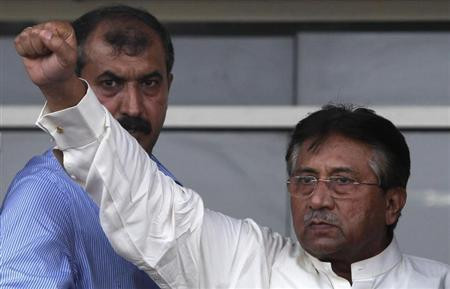Pakistan's former President Pervez Musharraf gestures to his supporters upon his arrival from Dubai at Jinnah International airport in Karachi March 24, 2013. REUTERS/Akhtar Soomro