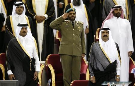 Qatar's Emir Sheikh Hamad bin Khalifa al-Thani (R) stands next to his son Crown Prince Sheikh Tamim bin Hamad al-Thani before the Emir Cup final match between Al-Sadd and Al-Rayyan at Khalifa stadium in Doha May 18, 2013. REUTERS/Fadi Al-Assaad