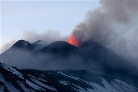 Italy's volcanic Mount Etna spews lava during an eruption on the southern Italian island of Sicily April 11, 2013. Mount Etna is Europe's tallest and most active volcano. REUTERS/Antonio Parrinello