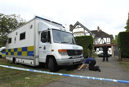 A police officers stands outside the home of Saad al-Hilli in Claygate, south of London September 10, 2012. REUTERS/Olivia Harris