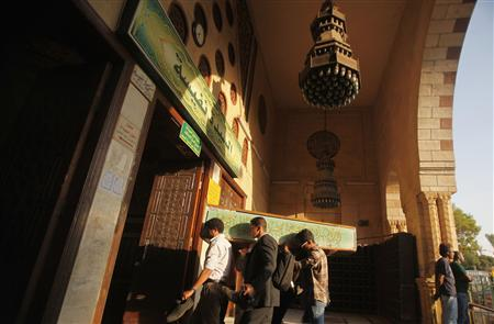 Egyptians carry the coffin of a Shi'ite victim, who was killed in sectarian violence, before funeral prayers in El Sayeda Nafisa Mosque in Cairo, June 24, 2013. REUTERS/Amr Abdallah Dalsh