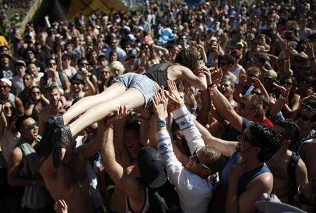 A woman crowd surfs across dancers at the Do Lab at the 2012 Coachella Valley Music and Arts Festival in Indio, California April 14, 2012. REUTERS/David McNew