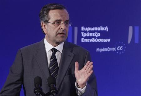 Greece's Prime Minister Antonis Samaras gestures as he delivers his speech during an agreement signing with the European Investment Bank (EIB) in Athens June 12, 2013. REUTERS/John Kolesidis