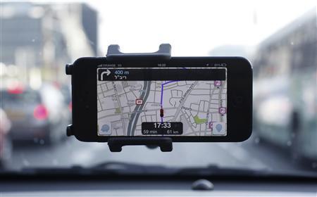 Waze, an Israeli mobile satellite navigation application, is seen on a smartphone in this photo illustration taken in Tel Aviv May 9, 2013. REUTERS/Nir Elias