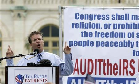 Sen. Rand Paul (R-KY) addresses the crowd during a Tea Party rally to ''Audit the IRS'' in front of the U.S. Capitol in Washington June 19, 2013. REUTERS/Gary Cameron