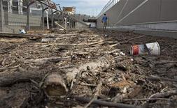 Debris left from flood waters litters a downtown sidewalk in Calgary, Alberta June 24, 2013. REUTERS/Andy Clark