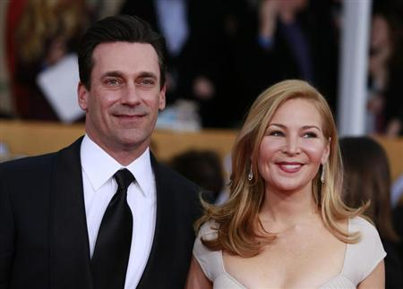 Actor Jon Hamm of the TV drama ''Mad Men'' and his girlfriend Jennifer Westfeldt arrive at the 19th annual Screen Actors Guild Awards in Los Angeles, California January 27, 2013. REUTERS/Adrees Latif
