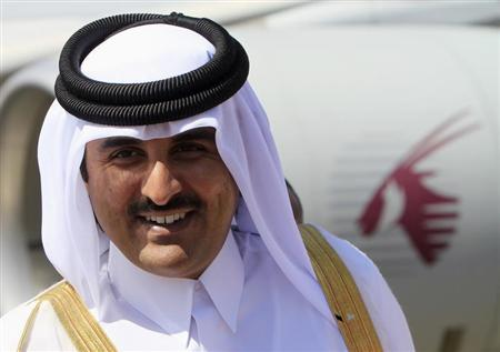 Qatar's Crown Prince Sheikh Tamim Bin Hamad Al Thani smiles during his arrival for an economic ties visit at Khartoum Airport December 4, 2011. REUTERS/Mohamed Nureldin Abdallah