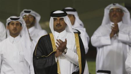 Qatar's Crown Prince Sheikh Tamim bin Hamad al-Thani (C) arrives at Al-Sadd Stadium for the final Crown Prince Cup soccer match between Qatari teams Al-Sadd and Lekhwaiya in Doha May 4, 2013. REUTERS/Fadi Al-Assaad
