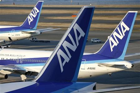Aircraft of Japan's second-largest airline All Nippon Airways Co., Ltd. (ANA) sit parked at Haneda airport in Tokyo January 17, 2009. REUTERS/Stringer