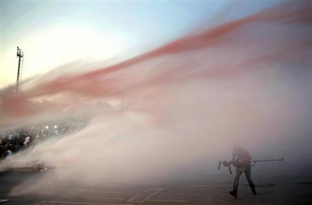 Protesters are attacked by police water cannon at the entrance Gezi Park near Istanbul's Taksim square June 15, 2013. REUTERS/Yannis Behrakis