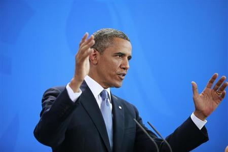 U.S. President Barack Obama gestures during a news conference after his meeting with German Chancellor Angela Merkel at the Chancellery in Berlin, June 19, 2013. REUTERS/Thomas Peter