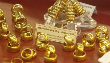Gold rings are displayed for sale at a Bao Tin Minh Chau gold shop in Hanoi June 21, 2013. REUTERS/Kham