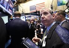 Traders work on the floor at the New York Stock Exchange, June 24, 2013. REUTERS/Brendan McDermid