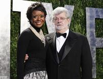 Director George Lucas and his partner Mellody Hobson arrive at the 2012 Vanity Fair Oscar party in West Hollywood, California February 26, 2012. REUTERS/Danny Moloshok