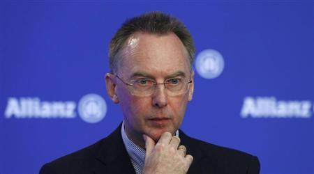 Dieter Wemmer, chief financial officer of Europe's biggest insurer Allianz SE, gestures during the company's annual news conference in Unterfoehring near Munich February 21, 2013. REUTERS/Michaela Rehle