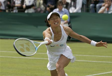 Kimiko Date-Krumm of Japan hits a return to Carina Witthoeft of Germany during their women's singles tennis match at the Wimbledon Tennis Championships, in London June 25, 2013. REUTERS/Eddie Keogh